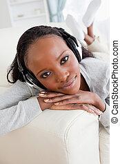 Close up of woman on sofa enjoying music