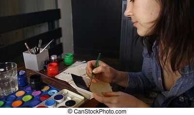close-up of woman painting