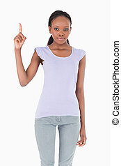 Close up of woman pointing up on white background