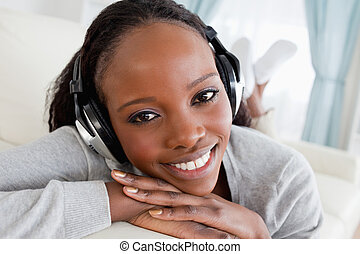 Close up of woman relaxing with music on her couch