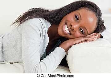 Close up of woman resting on sofa