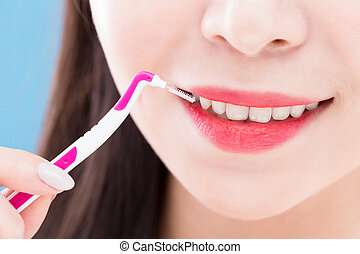 woman take interdental brush - close up of woman take...
