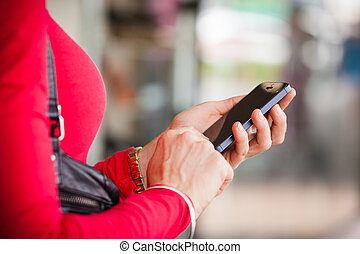 Close-up of woman texting