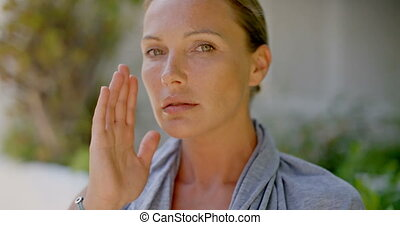 Close Up of Woman Touching Face with Hand