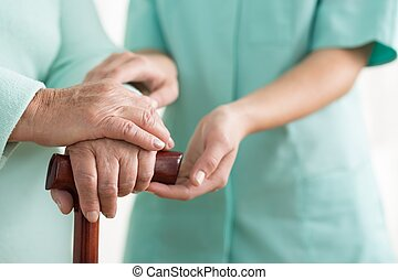 Close-up of woman using cane