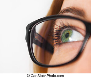 Close up of woman wearing black eye glasses looking up