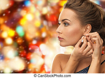 close up of woman wearing earrings