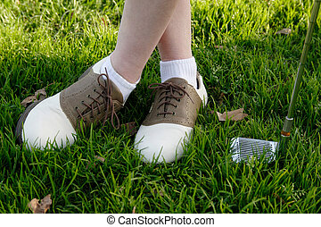 Close up of woman wearing golf shoes