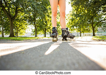 Close up of woman wearing inline s
