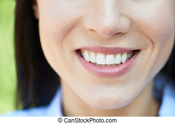 Close Up Of Woman With Beautiful And Perfect Teeth