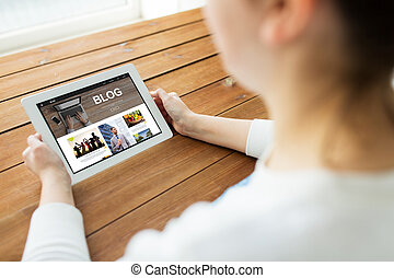 close up of woman with blog on tablet pc