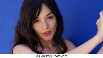 Close up of woman with brown eyes and long hair looking...