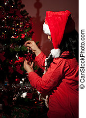 Close up of woman with Christmas tree