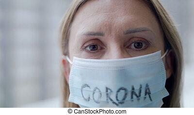 Close-up of woman with face masks looking at camera, corona ...
