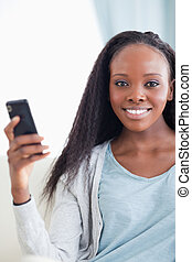 Close up of woman with smartphone