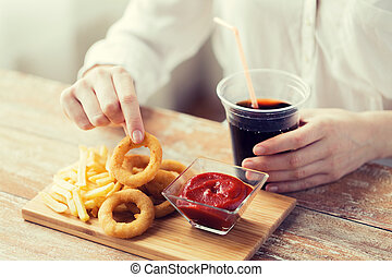close up of woman with snacks and cola - fast food, people...