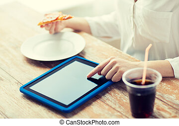 close up of woman with tablet pc counting calories