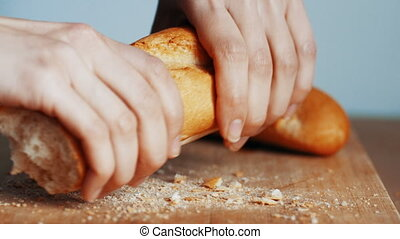 Close up of womand hands slicing french bread, 4k