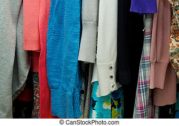 close up of woman's clothing hanging in closet