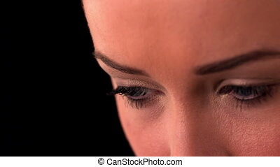 Close up of womans eyes on black b