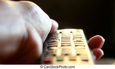 Close up of woman's hand with a television remote control...