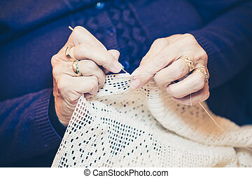 Close-up of woman's hands crocheting