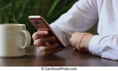Close Up of Woman's Hands Using Mobile Phone at Coffee Break