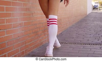 Close Up Of Womans Legs In White Knee-High Socks - Rear view...