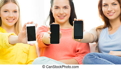 close up of women or friends with smartphones