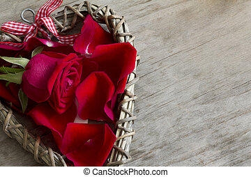 Close Up of Wooden Heart with Rose and Petals with Copy Space