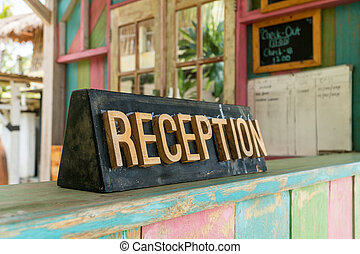 Close up of wooden reception desk in a low budget motel. Tourism and hospitality concept