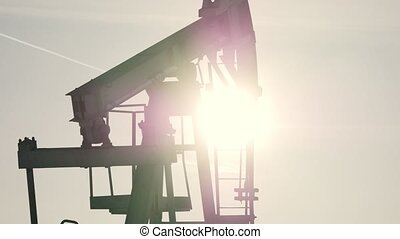 Close-up of working oil pump in a bright sunny day