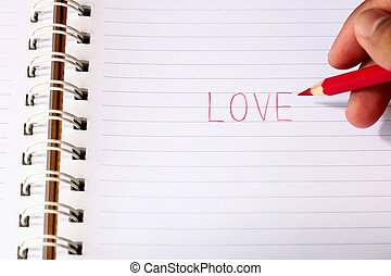 Write the word love with red pencil in blur man's hands