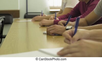 Close-up of writing hands of students at school HD