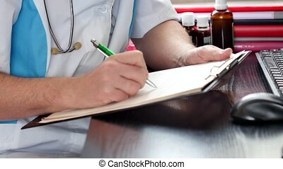 Close up of writing medical rx prescription. Doctor working...