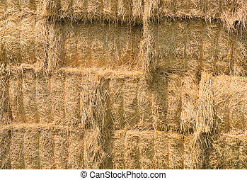 Close up of yellow hay bales.
