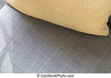 Close Up of Yellow Pillow on Gray Cushion