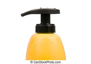 Close up of yellow shampoo bottle cap