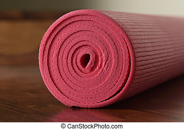 yoga mat simple close up of a yoga mat rolled up in a