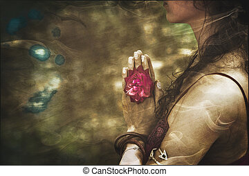 close up of yoga woman hands in namaste gesture with rose...