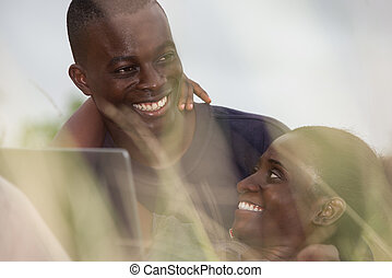 close up of young african couple, happy.