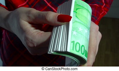 close up of young business girl with pack of money euro in hands