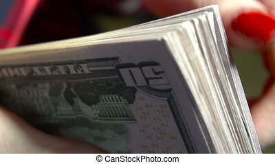 close up of young business girl with pack of money in hands