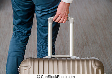 Close up of young business man with suitcase luggage on the carp
