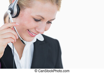 Close-up of young business woman wearing headset