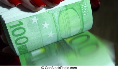 close up of young business woman with pack of money euro in hands