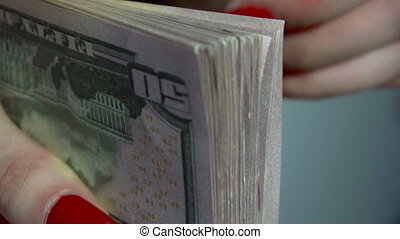 close up of young business woman with pack of money in hands