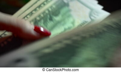 business woman with pack of money in hands