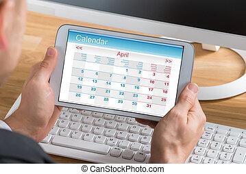 Businessman Using Calendar On Digital Tablet