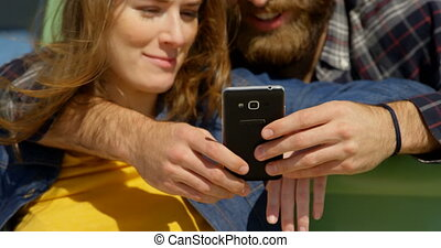 Close-up of young couple discussing on mobile phone 4k